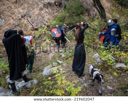 People play  games in nature era of the Middle Ages