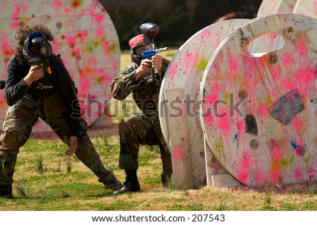 People playing paintball - stock photo