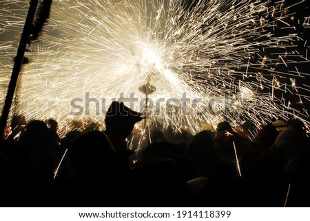 People playing with pyrotechnics in the street at a village. People having fun Stock photo ©
