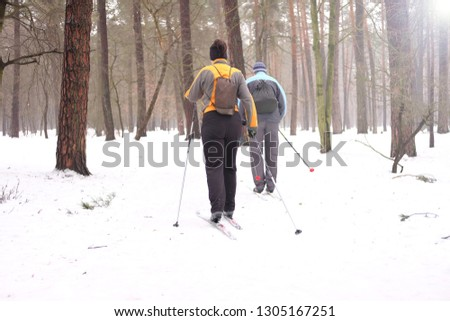 people practice skiing in winter, sports and recreation  #1305167251