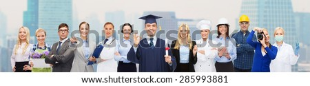 people, profession, education and success concept - happy bachelor with diploma over different workers over city background