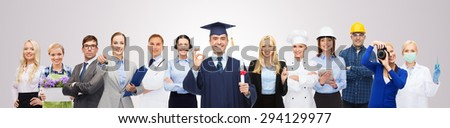 people, profession, education, gesture and success concept - happy bachelor with diploma showing ok sign over different workers and gray background