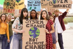 People protesting against multicultural opinion. Young people from different countries showing their ideology. Students together under same defense. Climate change concept.