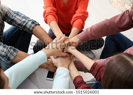 People putting hands together, closeup. Unity concept #1015026001