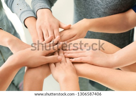 People putting hands together, closeup. Unity concept #1306587406