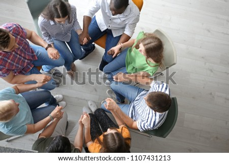 People putting hands together indoors, top view. Unity concept #1107431213