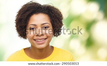 people, race, ethnicity and portrait concept - happy african american young woman face over green natural background