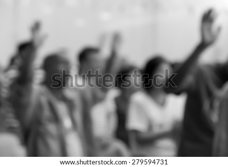 People raising hands to worship with singing choir for religion background