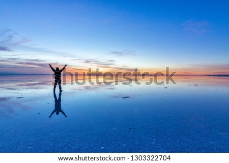 People reflections at Uyuni saltflats. One of the most amazing things that a photographer can see. The sunrise over an infinite horizon with the Uyuni salt flats making a wonderful mirror to infinity