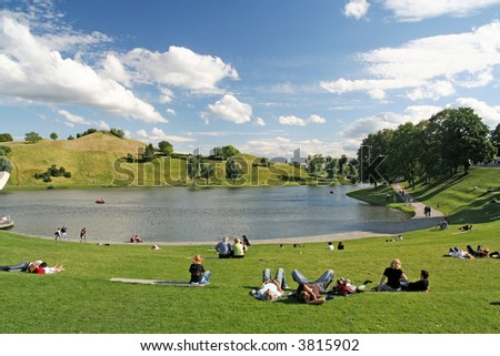 People relaxing and strolling in the Olympic park of Munich