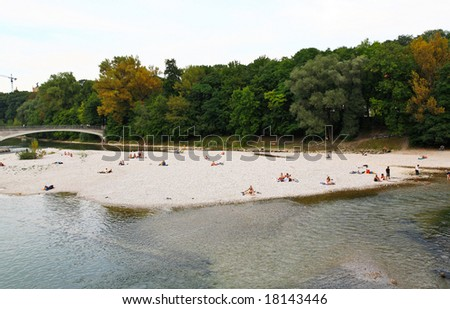 People relaxing at beach of a river in Munich #18143446