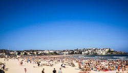 people relaxing at bondi beach on christmas day