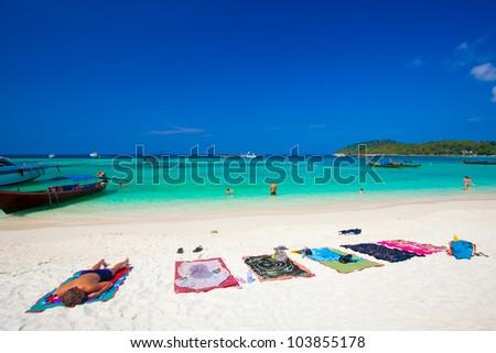 people relaxing on a Bundhaya beach koh lipe thailand