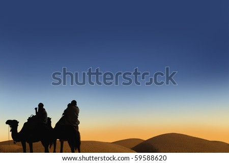 People ridding by camel on the sunset - stock photo