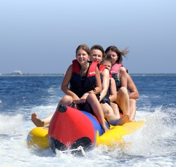 People ride on a banana boat.