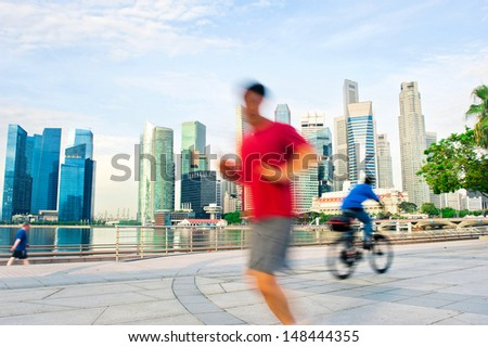 People runing and cycling in the morning in Singapore - stock photo