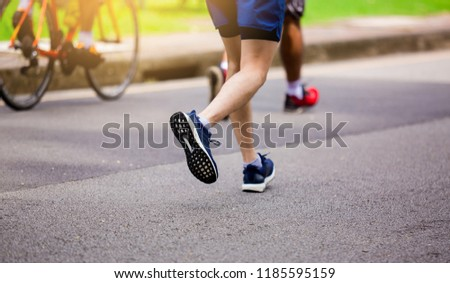 People running at park outdoor in the morning. Sports healthy lifestyle concept. #1185595159