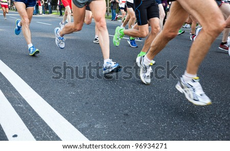 People running fast in a city marathon on street