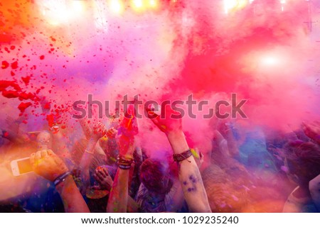 People rush blue and red paint on Holi celebration 9 September 2017 Moldova Chisinau Darwin Color Fest