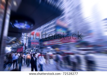 people rushing on the street in motion blur