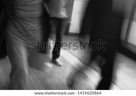 People rushing to go somewhere during rush hour black and white #1419620864