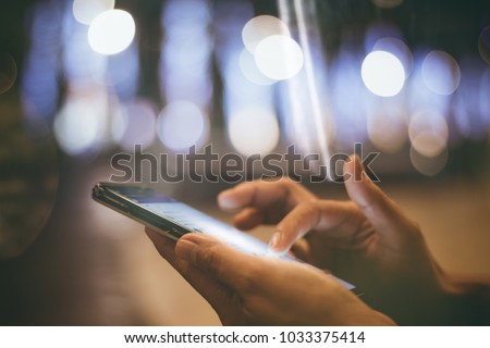 people 's hands using,playing mobile phone with fun and happy  , bokeh background..