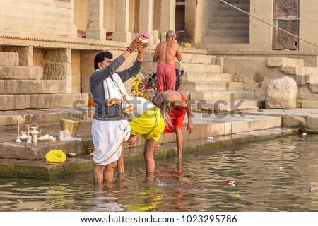 people sacrifice the Ganges river, Varanasi, Uttar Pradesh, India #1023295786