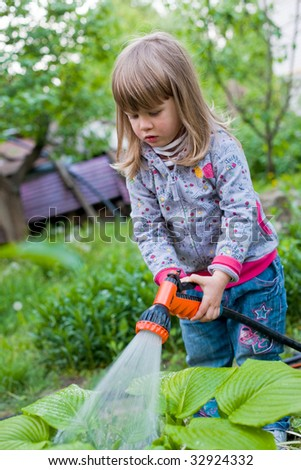 people series:l ittle girl in garden are pouring to water