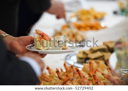 People serving at wedding buffet