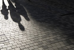 People shadow on the pavement