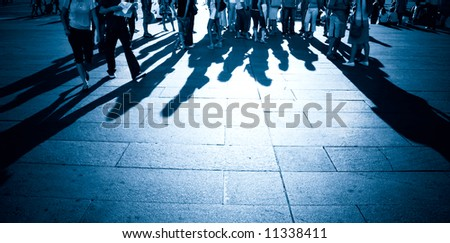 People shadows on a ground. Blue tint.