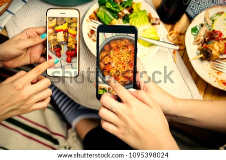 People sharing food photos on mobile phones