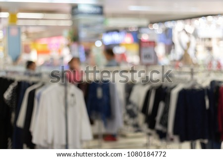 People shopping in department store interior. Defocused blur background. #1080184772