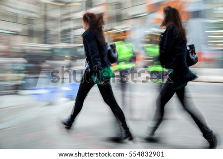 people shopping in the city in motion blur #554832901