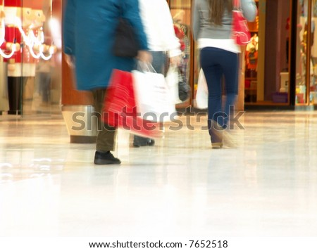 People shopping inside a mall (Focus is more on the front areas & sharpness is a little off to highlight motion & obscure logos/faces, photo composition allows you to add text & other contents easily)