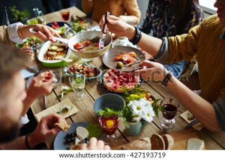 People sitting at dining table and eating