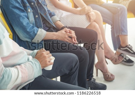 People sitting in circle, aa meeting, support group, therapy and psychiatry concept.
