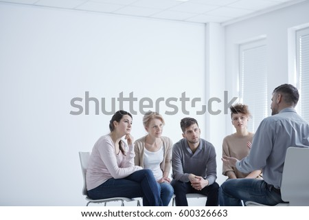 People sitting in circle during group therapy for social anxiety