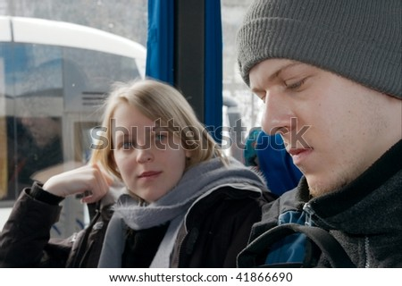 People sitting on a bus in winter - stock photo