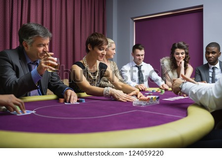 People sitting playing poker at the table