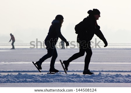 People skating on a frozen lake, Holland