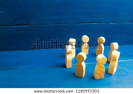 People stand in a circle. A circle of people. The concept of discussion and cooperation, coordination and cooperation. Communication. Business team, teamwork, team spirit. Wooden figures of people. #1180993303