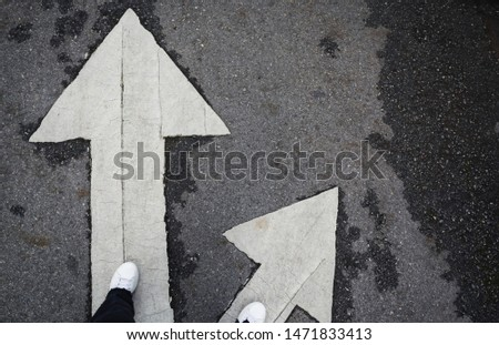 People standing at the crossroad and get to decision which way to go with copy space for insert text. Two ways to choose concept.
