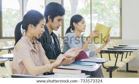 people student read book and sit in lecture chairs #733573324