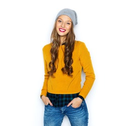 people, style and fashion concept - happy young woman or teen girl in casual clothes and hipster hat