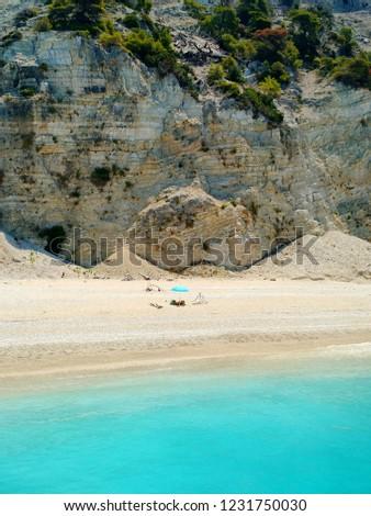 People suntanning at Egremni beach, Lefkada, Greece #1231750030