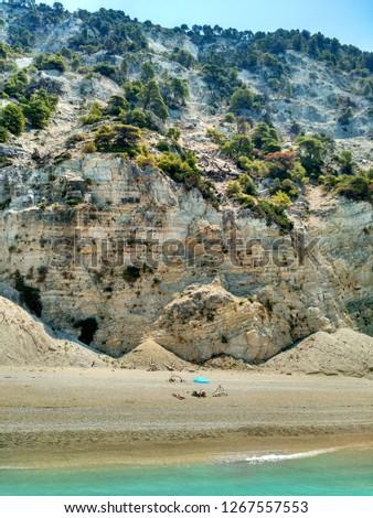 People suntanning at Egremni beach, Lefkada, Greece #1267557553