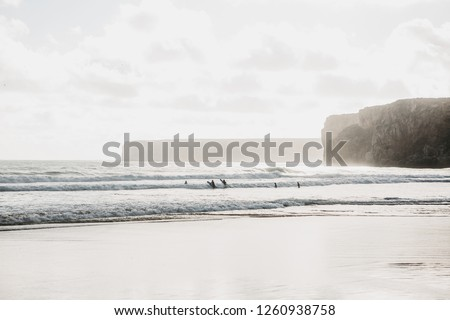 People surf. Active and extreme sport. Surfing. Interesting hobby or entertainment or pastime.