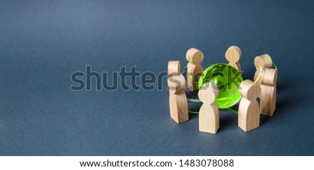 People surrounded a green Globe world planet earth. Diplomacy and crowdfunding. Concept of cooperation and collaboration of people and countries around the world. Outsourcing and joint work on project Photo stock ©