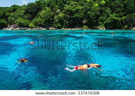 People swimming and snorkeling in summer at tachai island in Thailand